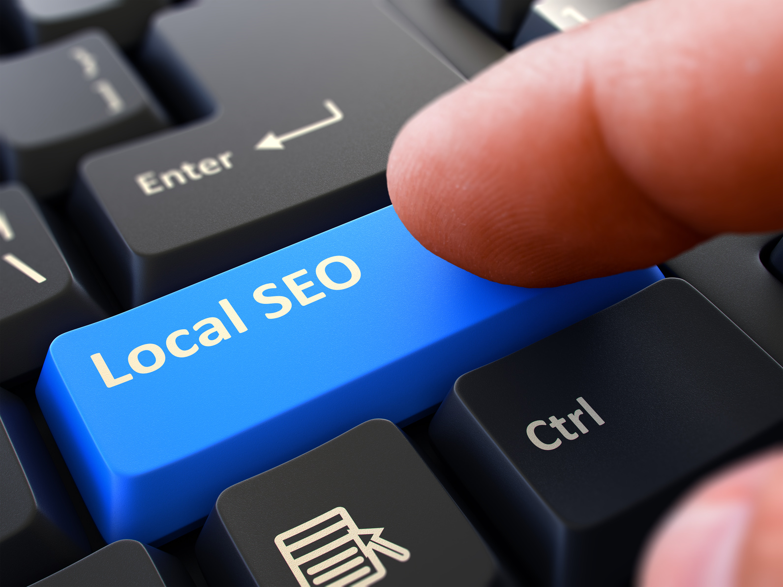 finger clicking Local seo on a keyboard representing Local Search Engine Optimization Valparaiso