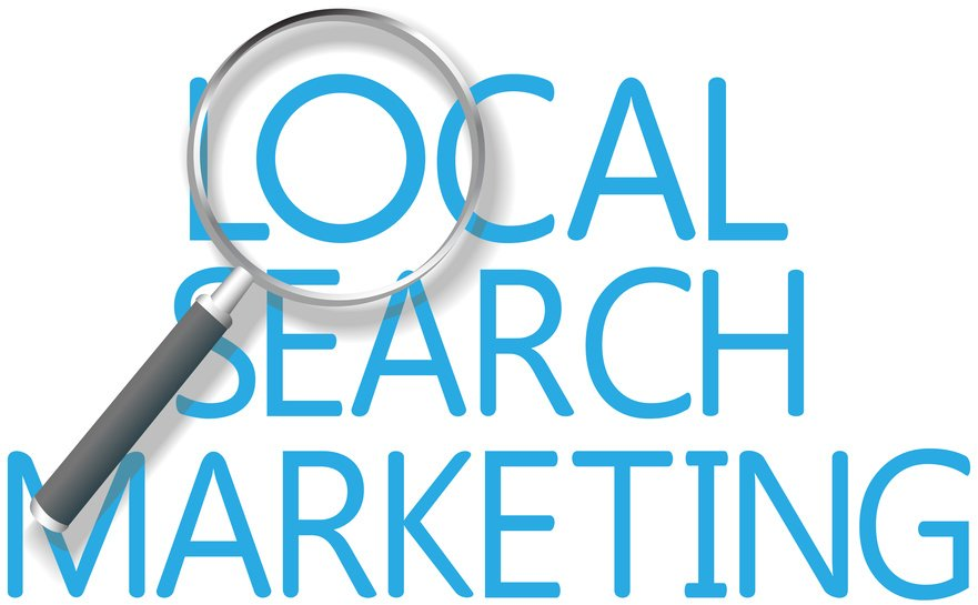magnifying glass on the words local search marketing for Local Search Engine Optimization Lowell