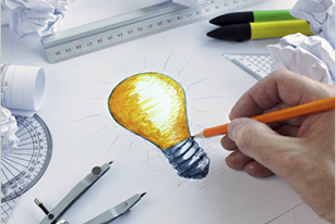 person drawing lightbulb for website designers best grand rapids