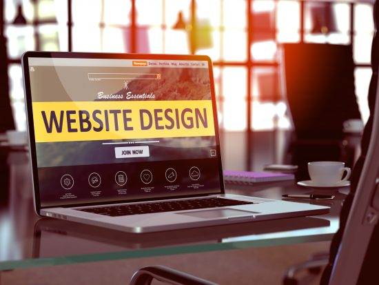 Laptop with web design concept pulled up from Evergreen Park website design company