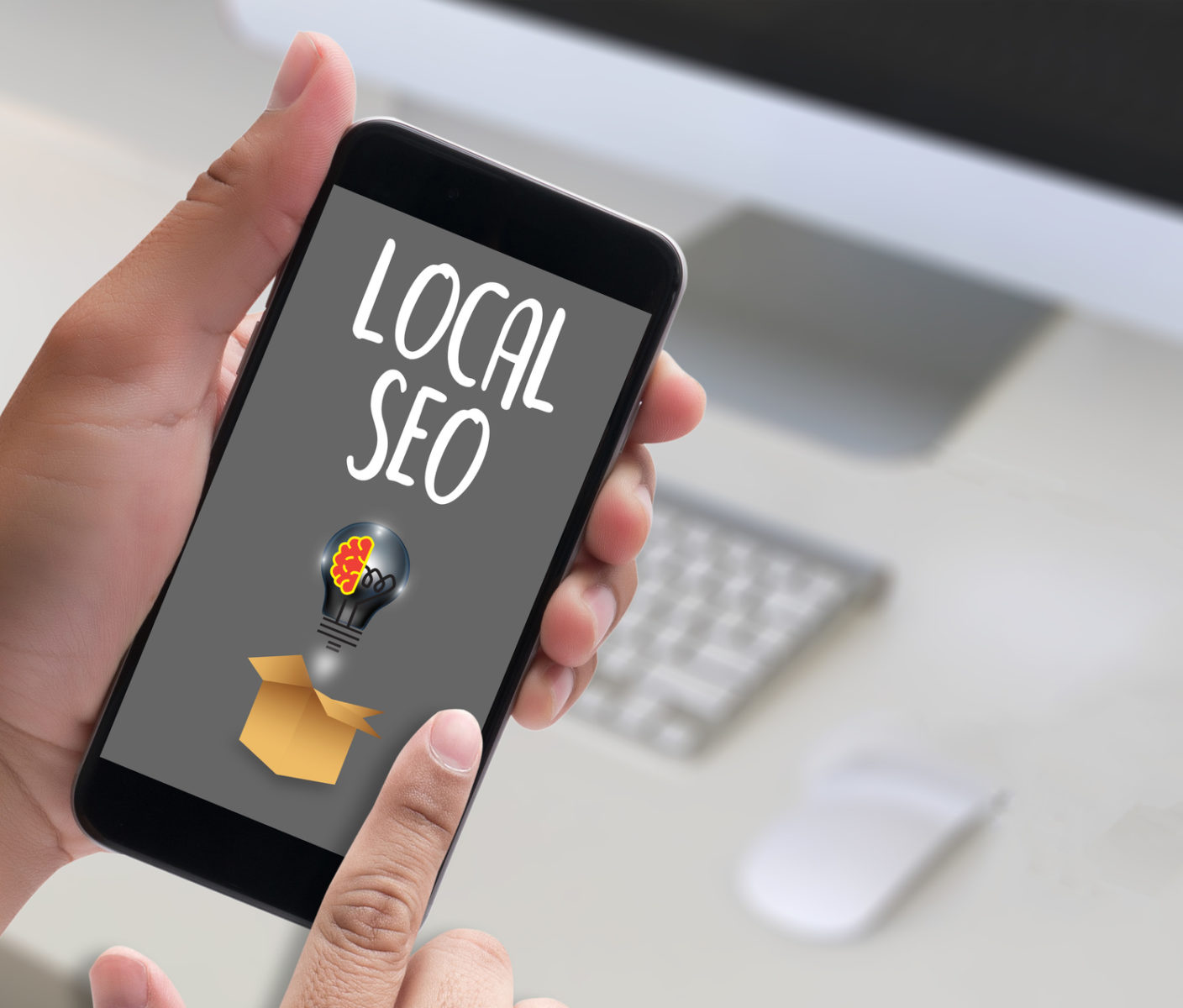Local SEO image on a cell phone and if you need local SEO services look no further than here in Crown Point.