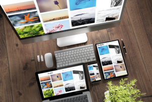 laptop, computer and tablets with photos on them representing how our Dyer website design company can design a beautiful site for you